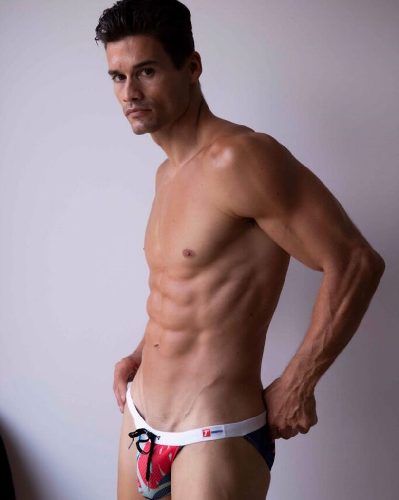 Model John Neda posing in Timoteo swimwear